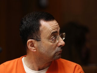 Ex-USA Gymnastics doctor pleads guilty