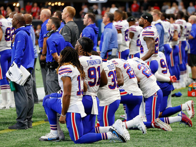 NFL owners approve penalty for kneeling players